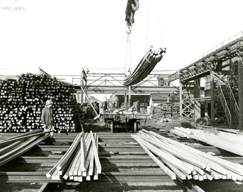 SYSCO heavy rolls mills, showing billets being stockpiled by overhead crane in the small billet yard. (Source: Beaton Institute)