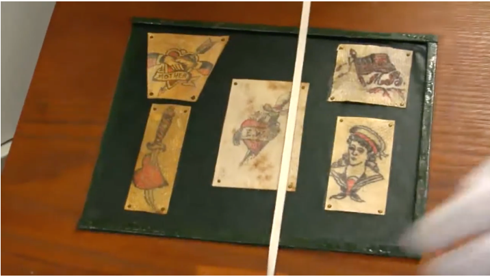 Tattoos attached to wooden board