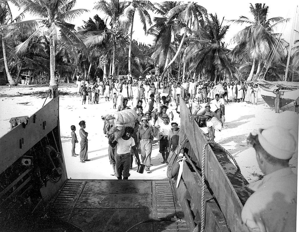 Bikini Islanders board a landing craft, vehicle, personnel (LCVP) as they depart from Bikini Atoll in March 1946