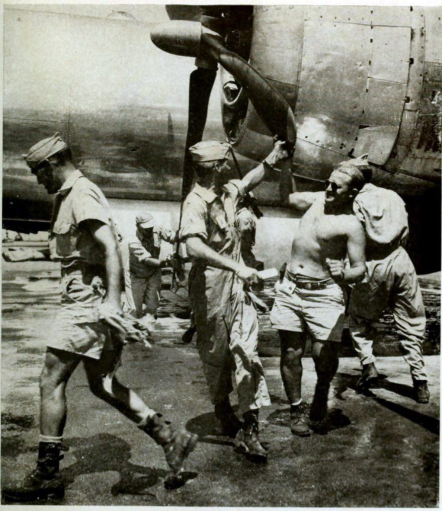 """Crew members of """"Dave's Dream,"""" B-29 Super Fort atomic bombing plane, prepare for the bombing mission. Circa 1946"""