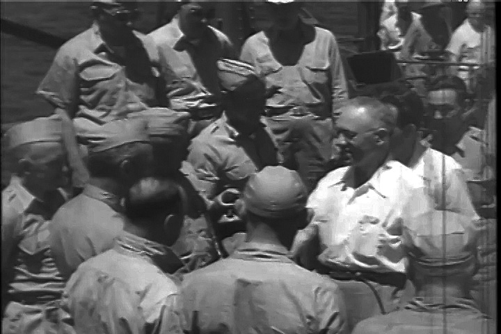 Soviet observer Simon Peter Alexandrov greeted by Secretary of the Navy James Forrestal and his party on board the U.S.S. Panamint. Alexandrov was in charge of uranium ore procurement for the Soviet atomic bomb project.