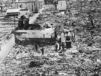 Indian soldiers wander in destroyed Hiroshima, June 1946. (Unknown author, Public Domain via Wikimedia Commons.)
